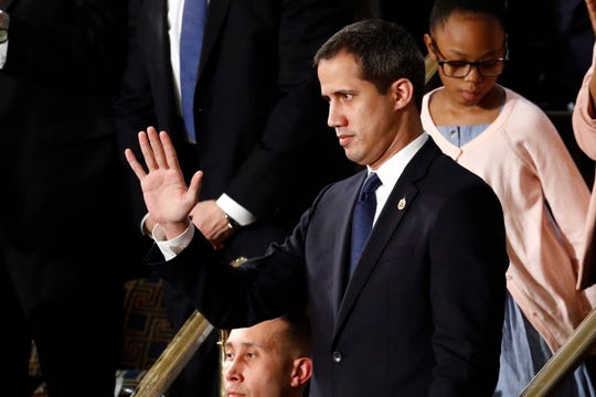 Venezuelan opposition leader Juan Guaido waves as President Donald Trump delivers his State of the Union address to a joint session of Congress on Capitol Hill in Washington, Tuesday, Feb. 4, 2020.