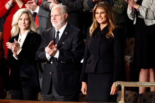 First Lady Melania Trump arrives before President Donald Trump delivers his State of the Union address to a joint session of Congress on Capitol Hill in Washington, Tuesday, Feb. 4, 2020. At center is Rush Linbaugh.