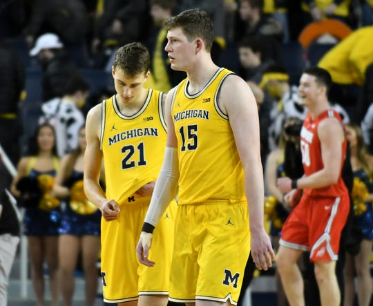 From left, Franz Wagner and Jon Teske walk off the court after the loss.