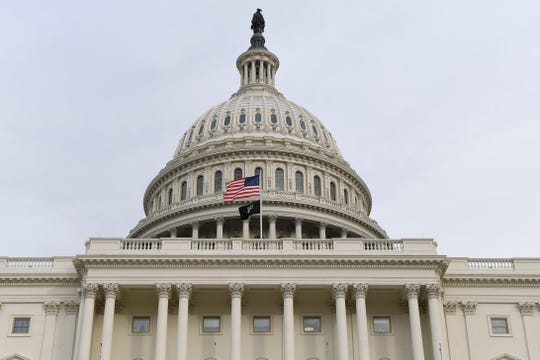 The flag flies outside the U.S. Capitol ahead of President Donald Trump delivering his State of the Union address to a joint session of Congress on Capitol Hill in Washington, Tuesday, Feb. 4, 2020.