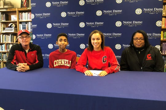 Elmira Notre Dame senior Alyssa Walker, third from left, during a signing celebration Feb. 5, 2020 at Notre Dame High School. Also pictured are her mom, Kim Walker; her dad, Charles Walker; and her brother, Kyle Walker.