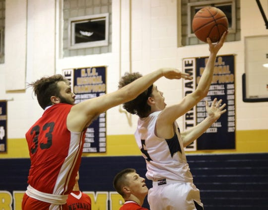 Joe Sheehan of Elmira Notre Dame takes the ball to the basket as Newark Valley's Ethan Bigelow defends during the Crusaders' 66-49 win in boys basketball Feb. 4, 2020 at Notre Dame High School.
