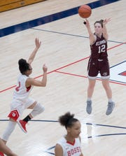 Mount Vernon's Paige Robinson (12) takes a three-point shot during the IHSAA Class 3A girls basketball sectional game against the Bosse Lady Bulldogs at Heritage Hills High School Tuesday evening, Feb. 4, 2020.