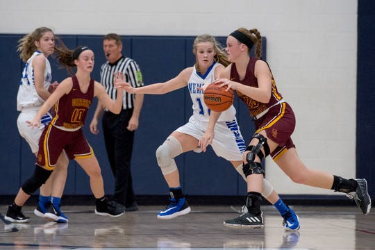 Memorial's Peyton Murphy (12) guards Gibson Southern's Meredith Raley (25) during the Class 3A girls basketball sectional game against the Gibson Southern Titans at Heritage Hills High School Tuesday evening, Feb. 4, 2020.