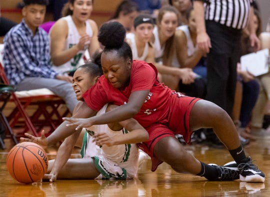 North's Jaidn Green (3) and Harrison's Daiyauna Wright (11) battle for the ball during the IHSAA 4A Girls Basketball Sectional at Harrison High School Tuesday night, Feb. 4, 2020.