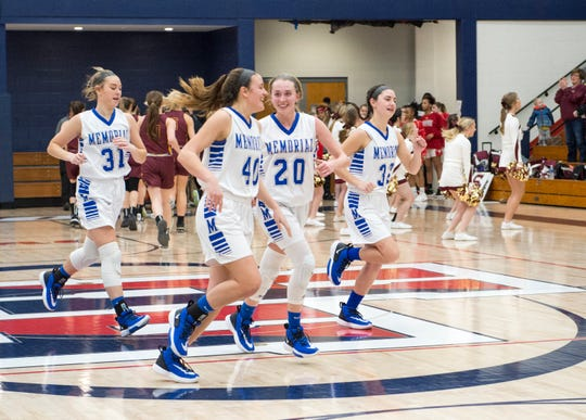 The Memorial Lady Tigers celebrate their win over the Gibson Southern Titans as they head to the locker room after the Class 3A girls basketball sectional at Heritage Hills High School Tuesday evening, Feb. 4, 2020.