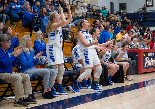 Memorial Lady Tigers bench erupts in cheers during the IHSAA Class 3A girls basketball sectional game against the Gibson Southern Lady Titans at Heritage Hills High School Tuesday evening, Feb. 4, 2020.