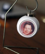 A Christmas ornament with a picture of Maynard Bloomer that his sister, Lois Midtvedt, has on display at her Howard home. Bloomer was killed in 1991 in Eau Claire when teenagers dropped a large rock onto his vehicle from an overpass.