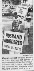 Pricilla Bloomer, front, and her son Jeff protested outside the Eau Claire County Courthouse prior to a 1991 hearing for two juveniles who killed her husband, Maynard Bloomer, when they threw a rock off an overpass, striking the Bloomer family's vehicle.
