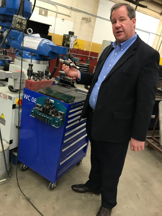 Luxemburg-Casco School District Sup. Glenn Schlender talks about equipment upgrades in the school's metal fabrication shop as part of the school's $27.8 million renovation project.