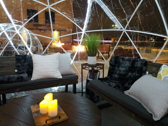 The Riverside Igloos on Hagemeister Park's patio are made cozy with pillows, blankets, flameless candles and portable heaters.