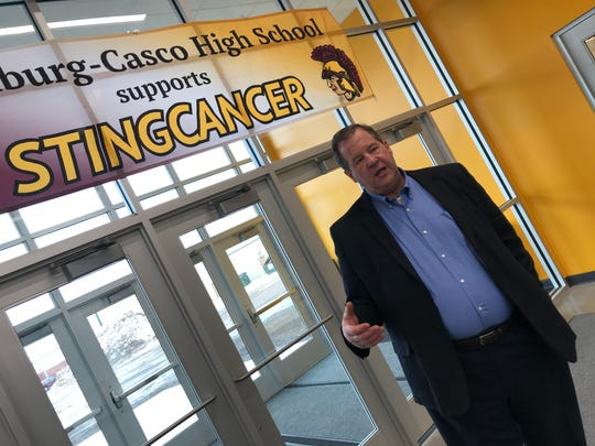 Luxemburg-Casco School District Sup. Glenn Schlender talks about the benefits of the new school gymnasium in the entrance to the gym.