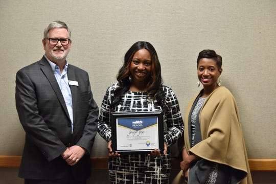 Jennifer Jones, the November 2019 Greenville News Community Hero honoree, poses with Paul Hughes, CEO/President- Greenville Federal Credit Union and Katrice Hardy, USA TODAY Network South regional editor and executive editor of The Greenville News.