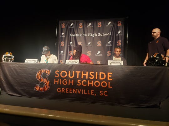 Southside High School football players (from left to right) Braydon Bennett, Ty Dendy and Marc Smith sign their national letters of intent Wednesday at Southside.