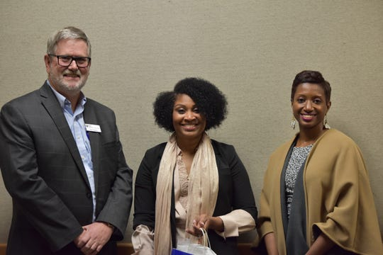 Nika White, Greenville News Community Hero for October 2019, poses with Paul Hughes, CEO/President- Greenville Federal Credit Union and Katrice Hardy, executive editor of The Greenville News.