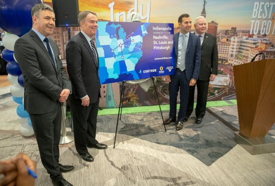 Steven Small (left), Joe Hogsett, Matt Chaifetz, and Jim Schellinger at an announcement by Contour Aviation to beef up direct flights with service to out-of-state cities Nashville, St. Louis, and Pittsburgh, Indianapolis, Wednesday, Feb. 5, 2020.