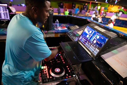 Elmer Akers, DJ and long-time skater, plays some old school music during adult night at Skateland on Thursday, June 6, 2019.