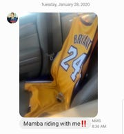 "Columnist Rachel James Terry's husband - a huge Kobe Bryant fan -  texted her a picture of his Kobe jersey nicely seated in the passenger side of his car following the basketball legend's death. He included the words ""Mamba is riding with me."""