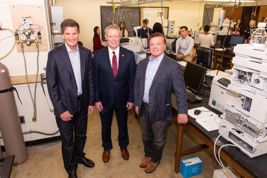 Business professionals Jim Duff, left, and Thomas Duff, right, of Hattiesburg, visit with University of Mississippi Chancellor Glenn Boyce about their gift of $26 million toward construction of a new STEM facility on the Oxford campus. Ole Miss students, such as those pictured in this Coulter Hall chemistry lab, will benefit from state-of-the-art active learning spaces in the new 202,000-square-foot building.