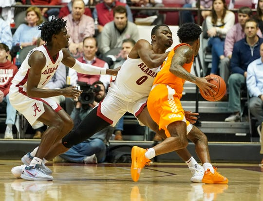 Feb 4, 2020; Tuscaloosa, Alabama, USA; Alabama Crimson Tide forward Javian Davis (0) reaches in against Tennessee Volunteers guard Jordan Bowden (23) during the second half at Coleman Coliseum. Mandatory Credit: Marvin Gentry-USA TODAY Sports