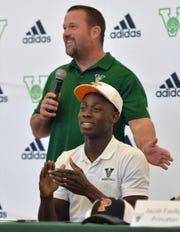 Venice (Florida) High  Malachi Wideman wears a University of Tennessee hat after football coach John Peacock introduced him during a ceremony in the school's gym on Feb. 5, 2020.