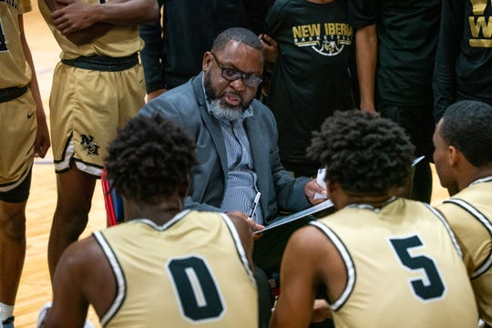 New Iberia head coach Todd Russ talks to his players during a timeout as the Comeaux High Spartans beat the New Iberia Yellow Jackets, 59-57, in double-overtime on Tuesday, Feb. 4, 2020.