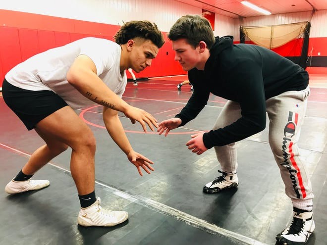 Liberty Union senior Kobe Barnett and junior Casey Fleahman have been wrestling partners for three years and credit each other for their success.
