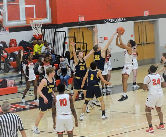 Lancaster's Tanner Roush blocks a Groveport players' shot during the Golden Gales 60-44 non-conference loss Tuesday night.
