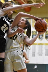 Howell's Kaylee Wendel drives to the basket against Plymouth's Ainsley Florence on Tuesday, Feb. 4, 2020.