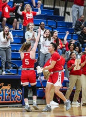 Jeff's Lily Haire (5) celebrates her last-second three-point shot in the first quarter with her teammates as the Red Devils beat the Highlanders in the girls sectional at Jennings County High School Tuesday night. Feb. 4, 2020.