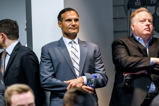 Michigan State Trustee Brian Mosallam, left, and Athletic Director Bill Beekman look on as Mark Dantonio speaks about his decision to retire as Spartans head football coach during a press conference on Tuesday, Feb. 4, 2020, at the Breslin Center in East Lansing. Dantonio made the announcement on Twitter earlier in the day.