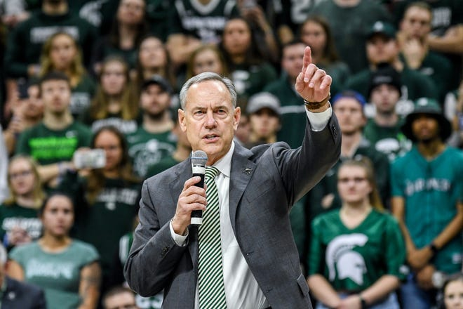 Mark Dantonio gives a short speech to fans during halftime of MSU's game against Penn State on Tuesday, Feb. 4, 2020, at the Breslin Center in East Lansing. Dantonio announced his retirement as head football coach earlier in the day.