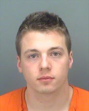Jack Estes Debrabander, 20, of East Lansing, was arrested in Florida on Feb. 1 and charged with battery. Police said he urinated on a woman over the railing of a balcony at a nightclub.