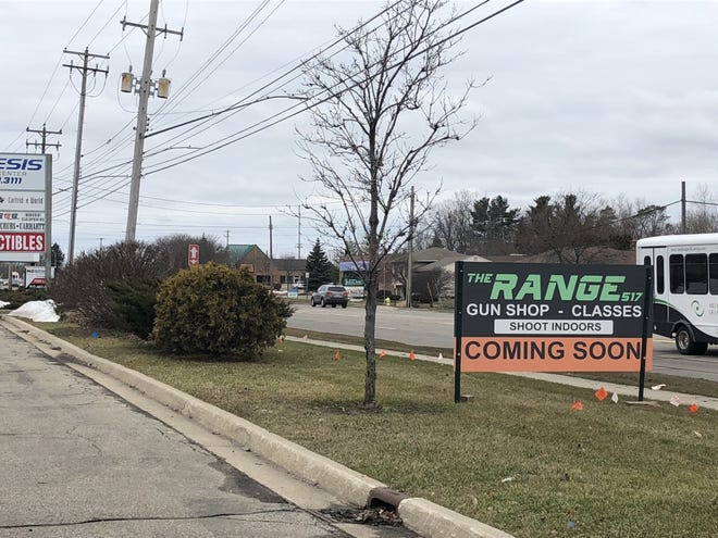 A sign off West Saginaw Highway in Delta Township advertising The Range 517, a gun shop and indoor shooting range planned for a former gym at 6135 W. Saginaw Hwy.