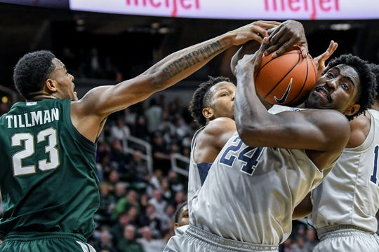 Michigan State's Xavier Tillman, left, and Penn State's Mike Watkins battle for a rebound during the first half on Tuesday, Feb. 4, 2020, at the Breslin Center in East Lansing.