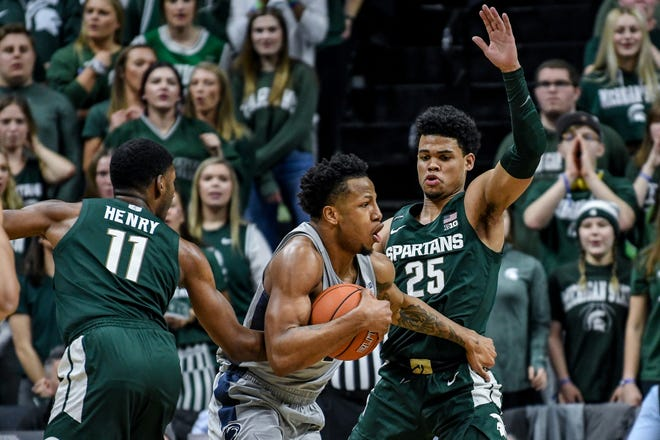 Michigan State's Malik Hall, right, pressures Penn State's Lamar Stevens during the first half on Tuesday, Feb. 4, 2020, at the Breslin Center in East Lansing.