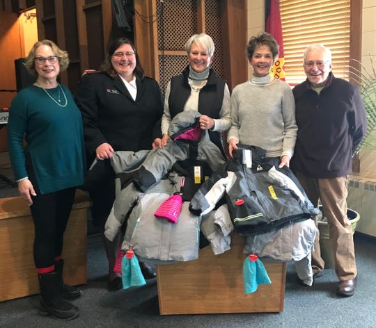Pictured are members of the Helen Gajdys Reis & Lester Reis Endowment Fund Board donating coats for kids to The Salvation Army (from left):Mary Reis, Salvation Army Lt. Jenny Moffitt, Jutta Furca, Gloria Theisand Howard Zimmerman.