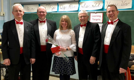 Manitowoc's Clipper City Chordsmen deliver a Singing Valentine.