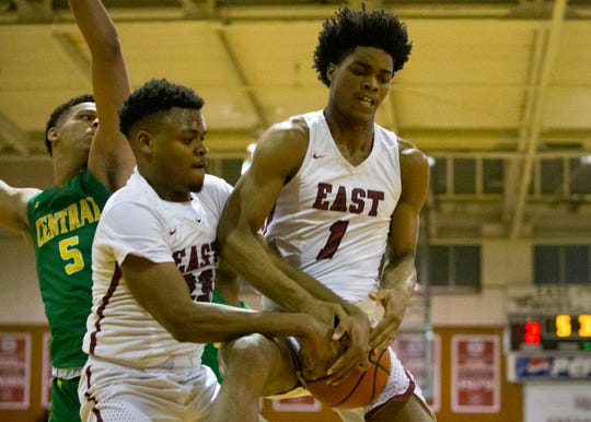 East Duane Posey (1) snags the rebound during a basketball game on Tuesday, Feb. 4, 2020 at East High School.