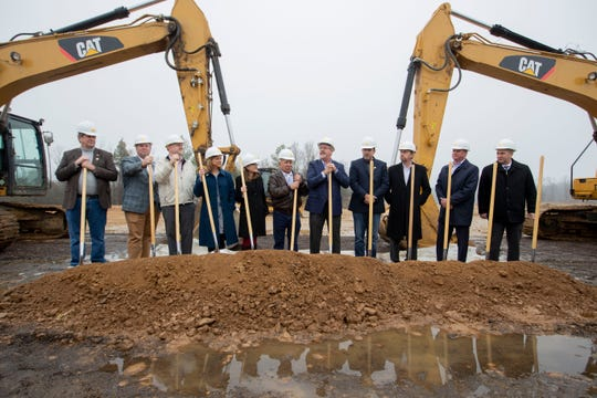 Dignitaries take turns speaking Wednesday, Feb. 5, 2020, before the ceremonial groundbreaking of The Lake District development in Lakeland.
