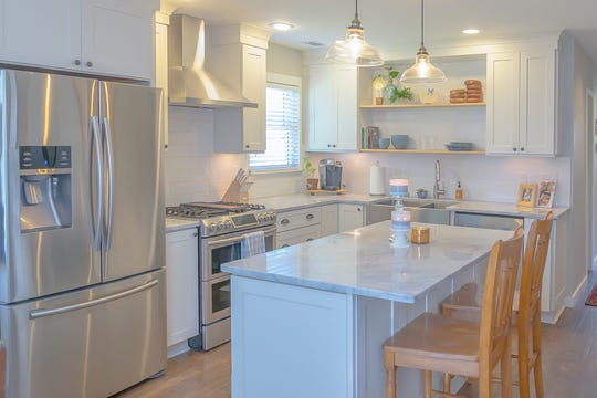 Sydney Ray's modern kitchen is a centerpiece of the Collierville cottage she purchased for her family.