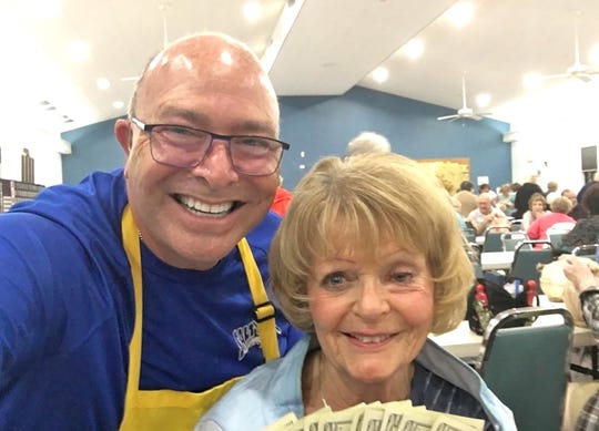 JCMI big winner Sally Rozak with Bingo committee member Mitch Braun.