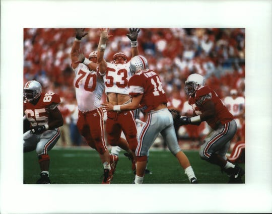Nose guard Jason Maniecki (70) and linebacker Chad Cascadden (53) arrive too late to bat down a pass by Ohio State quarterback Bobby Hoying in a 24-3 Badger loss in Columbus.