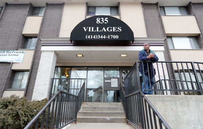 Damon White stands outside an apartment complex in the 800 block of North 23rd Street on Wednesday where, according to police, a 24-year old Milwaukee woman died of a gunshot wound.