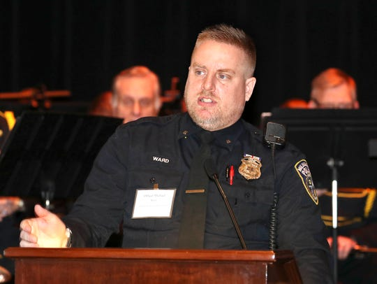 Milwaukee Police Officer Michael Ward receives the Outstanding Community Liaison Officer Award during the 71st Annual Crime Prevention Awards on Wednesday.