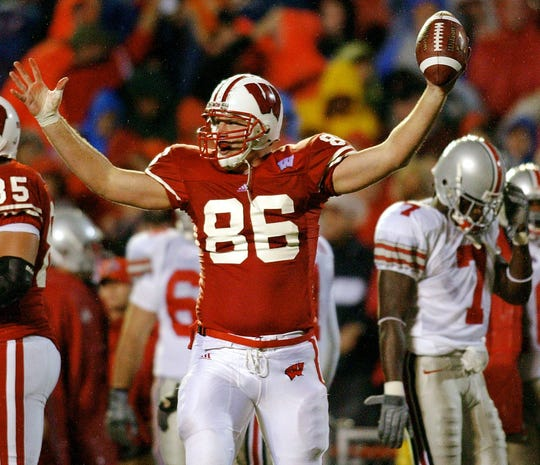 Wisconsin's Matt Katula (86) reacts after recovering a fumbled punt by Ohio State's Chris Gamble (7) in the second half Saturday, Oct. 11, 2003, in Madison, Wis.