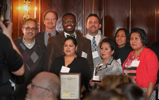 Members of the Clarke Square Neighborhood Initiative receive their award for Outstanding Greater Milwaukee Partnership during the 71st Annual Crime Prevention Awards on Wednesday.