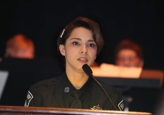 Milwaukee County Sheriff's Deputy Kristine Rodriguez receives the AAA Wisconsin Traffic Safety Law Enforcement Award during the 71st Annual Crime Prevention Awards on Wednesday.