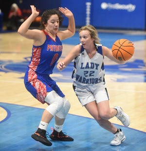 Cotter's Kaylee Crownover drives to the basket during a game last week against Bruno-Pyatt. The Lady Warriors have won 10 of their last 11 games.