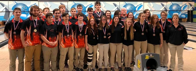 Norfork's boys' and girls' bowling teams are both pictured after winning the 2A/1A-West Conference championships on Monday at Lowell.